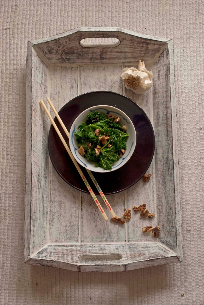 kale on tray with walnuts